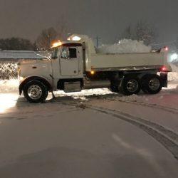 hauling away snow at night.