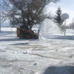 small bulldozer plowing snow.